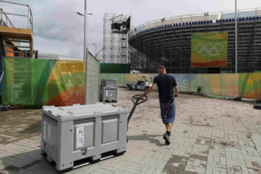 BACK TO THE DAILY GRIND! A worker pulls a storage bin in the Olympic Park a day after the closing ceremony of the Rio Olympic Games in Brazil. (Reuters/Bruno Kelly)