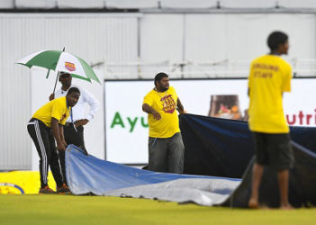 Attempted mopping up operations by ground-staff at Queen's Park Oval were all in vain.