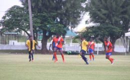 Jeremy Garrett (centre) of Fruta Conquerors in the process of receiving the ball while being pursued by Creek FC opposing player during their u17 matchup at the Camp Ayanganna ground yesterday.