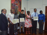 Minister within the Ministry of Education, Nicolette Henry, along with president of the GOA, K Juman-Yassin and some of Guyana's representatives at Rio 2016 pose for a photo opportunity following yesterday's presentations of Commendation Certificates.