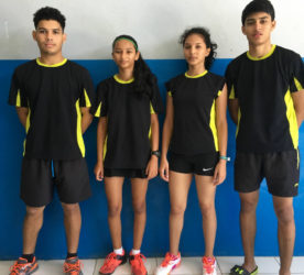 SECOND BEST! From left Jonathan Mangra, Priyanna Ramdhani, Ambika Ramraj and Narayan Ramdhani after they won a silver medal in the team event at the CAREBACO junior badminton championships in Aruba.