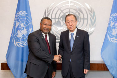 Ambassador Michael Ten-Pow (left) being congratulated by UN Secretary-General Ban Ki-moon (Ministry of Foreign Affairs photo)