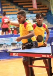 Kaysan Ninvalle and Abigail Martin in action during their mixed doubles matchup at the 2016 Caribbean Pre-Cadet Table Tennis Championships at the National Arena in Kingston, Jamaica.