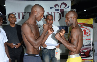 Ripped and Ready! Dexter Gonsalves and Demarcus Corley square off following the weigh in last night at the Giftland Mall. (Orlando Charles photo)