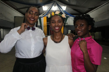 BowJay's owner Jenell Pierre (centre) poses with two of her models