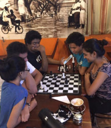 Some members of the 2016 Guyana Olympiad chess team during a practice session at the Oasis Café. The team travels to Baku, Azerbaijan, to participate in the 42nd Chess Olympiad.