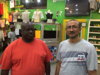Owner of Colours, Melton Branford (left) and Suresh Narine owner of Narine's Liquor Store.