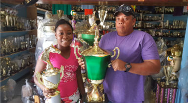 In picture, Tiana Lovell   of the Trophy Stall hands over the champion jockey trophy and the President's Cup to Wayne Campayne.