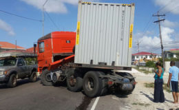 Around 3 pm yesterday, this container truck, which was heading towards the city, suffered a brake malfunction on the East Coast Demerara Public Road at Le Ressouvenir. Its driver Shane Singh was able to manouvre it to a halt. Aside from a leaking fuel tank, under which a bucket was placed, and slight damage to the body of the vehicle, the only other visible impact was the long line of backed up traffic along the roadway. Luckily, neither the driver nor his accompanying porter was injured and road users in the vicinity of the truck at the time of the incident escaped harm as well.