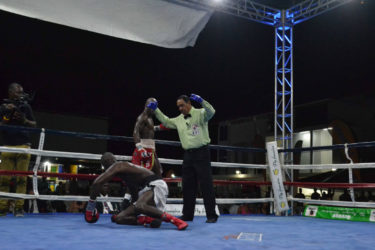 DeMarcus 'Chop Chop' Corley floors Dexter 'The Cobra' Gonsalves in round six en route to earning a majority decision victory to capture the vacant WBC FECARBOX lightweight title Saturday night at the Giftland Mall.