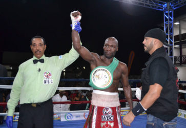 New WBC FECARBOX lightweight champ! Referee, Eon Jardine raises the hand of DeMarcus 'Chop Chop' Corley after a slugfest with Dexter 'The Cobra' Gonsalves Saturday night at the Giftland Mall.