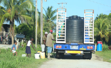 ne household presented several buckets to be filled as the GWI contracted truck made its way through the street.