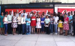 The bursary awards winners with company officials (Banks DIH photo)