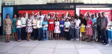The bursary awards winners with company officials (Banks DIH photo)