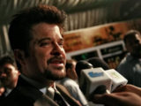 Bollywood actor Anil Kapoor speaks to reporters upon his arrival on the green carpet for the International Indian Film Academy (IIFA) awards in Colombo June 3, 2010. REUTERS/Dinuka Liyanawatte