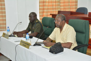 From right are Chairman of the CoI, Retired Colonel Desmond Roberts and CoI Secretary, Col. Denzil Carmichael (Ministry of the Presidency photo)