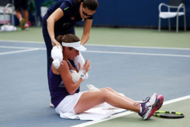 Johanna Konta of great Britain receives medical attention during her match against Tsvetana Pinkova of Bulgaria yesterday at the Us Open in Flushing Meadows. (Reuters photo)