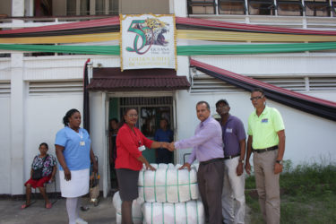 In photo: Silochanie Singh receives the donation from CEO of FFP Kent Vincent while Nurse Shaundelle Inniss-Munroe, Wayne Hamilton and Compton Giddings look on.