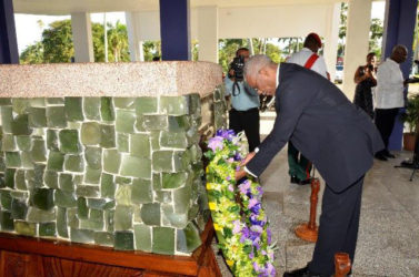 President David Granger lays a wreath at the Mausoleum in the Botanical Gardens. (Ministry of the Presidency photo)