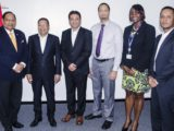 Prime Minister Moses Nagamootoo (left) and Head of Go-Invest, Owen Verwey with the HGS officials and Go-Invest official Uchenna Gibson (second from right)  (Office of the Prime Minister photo)