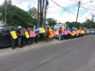 The picketers in front of the Ministry of Business on South Road yesterday.