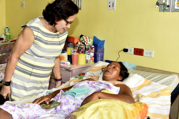 First Lady Mrs. Sandra Granger yesterday visited the recovering Ophelia James in the Female Surgical Ward of the Georgetown Public Hospital Corporation (GPHC). According to a statement issued by the Ministry of the Presidency, Mrs Granger extended condolences to James on the death of her two children and offered words of comfort and support to her. The attending physician also updated the First Lady on the woman's prognosis, the ministry said. (Ministry of the Presidency photo)