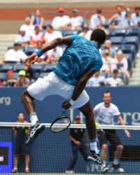 FLASHBACK! Gael Monfils of France hits a net ball between his legs to Jan Satral of the Czech Republic on day three of the 2016 U.S. Open tennis tournament at USTA Billie Jean King National Tennis Center.