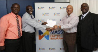 In picture, Branch Manager Lindel Harlequin gives the sponsorship cheque to Lusignan Golf Club President Oncar Ramroop. Looking on are (at left) Massy United Claims Officer Vibert Austin, and (at right) Golf Club PRO, Guy Griffith.