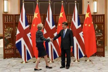 Chinese President Xi Jinping (R) shakes hand with British Prime Minister Theresa May before their meeting at the West Lake State House on the sidelines of the G20 Summit, in Hangzhou, Zhejiang province, China, September 5, 2016. REUTERS/Etienne Oliveau/Pool
