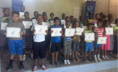 Some of the participants of the programme display their certificates.