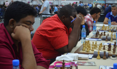 Taffin Khan, Ronuel Greenidge, Haifeng Su, partly hidden and Roberto Neto are all deep in concentration during yesterday's match against Bermuda. (Photos courtesy of Irshad Mohamed)