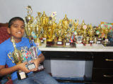Yovendra 'Nyan' Singh poses with his 28 trophies