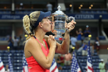 NEW QUEEN OF THE COURTS! Germany's Angelique Kerber kisses the silverware after her U.S. Open women's singles final triumph against Karolina Pliskova yesterday.