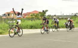 Junior Niles powering across the line to record his first victory of the 2016 season yesterday at West Demerara. (Orlando Charles photo)