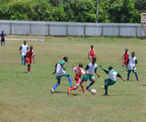 Action between Victoria Kings and BV/Triumph in the East Coast of Demerara zone of the Namilco Thunderbolt Flour U17 National Championships