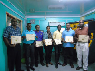 The seven lecturers who are now certified to operate the simulators.