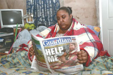 Marissa Nelson, who suffers from lymphoedema, reads the Guardian's article which highlighted her plight.