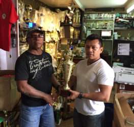 A Trophy Stall's representative, presented the championship trophy to GAPF'S Tyrone Eusibio yesterday ahead oftomorrow's fixture.