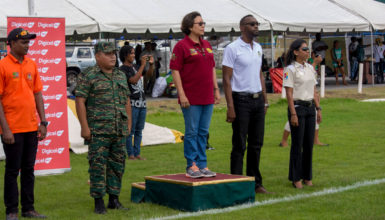 Minister within the within the Indigenous People's Affairs Valerie Garrido-Lowe (standing centre) alongside Director of Sport Christopher Jones (second from left) during the launch of the Indigenous Heritage Sports yesterday at the Everest Cricket Club ground on Carifesta Avenue.