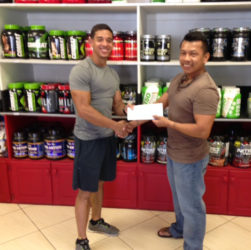 CEO of Fitness Express, Jamie McDonald handed over a sponsorship cheque yesterday to the GAPF'S Tyrone Eusibio to offset expenses of the meet.