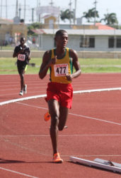 Odwin Tudor striding to victory in the boy's 5000m. (Orlando Charles photo)