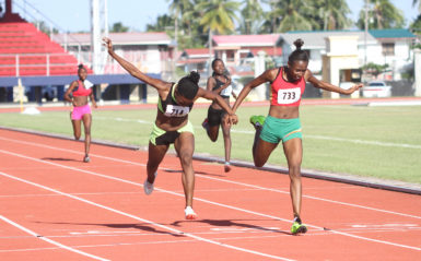 Action in the women's 200m yesterday. (Orlando Charles photo)