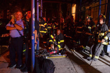 New York City firefighters stand near the site of an explosion in the Chelsea neighborhood of Manhattan, New York, U.S. September 17, 2016. REUTERS/Rashid Umar Abbasi