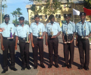 The police officers who were awarded for their outstanding performances.