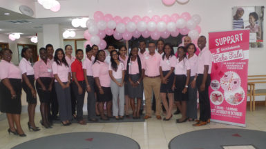 Staff of Scotiabank's Robb Street Branch at the launch of the cake sale.