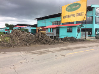 Two days after Monday evening's fatal accident, the mud pile was cleared off the road and heaped in the corner.