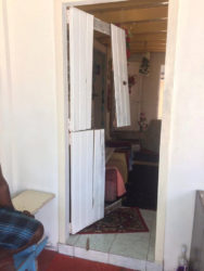 The door to the home that was broken by the bandits.