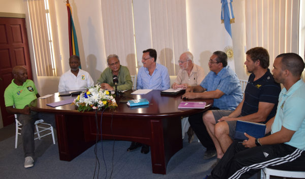 Press conference to introduce Argentine Rugby coach, Diego Giannantonio. Left to right: Local Head Coach Laurie Adonis, GOA representative Charles Corbin, Minister Dr. Rupert Roopnarine, Argentine Ambassador Luis Martino, GRFU Patron, Kit Nascimento, GRFU President Peter Green, rugby coach Diego Giannantonio and Nicolas Fraser, Interpreter. (See page 27)