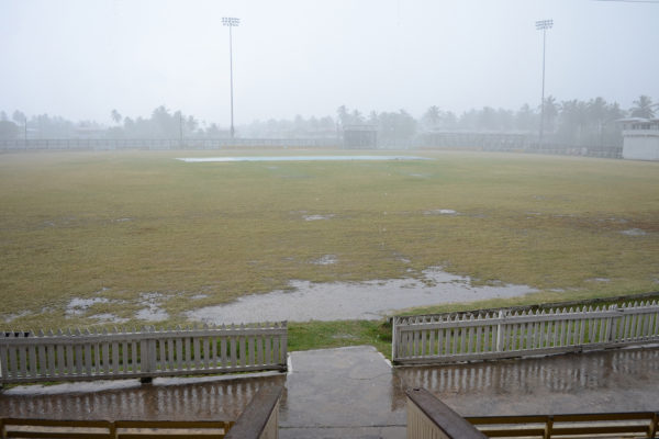 Heavy showers forced officials to call off play during the afternoon session. (Orlando Charles photo)