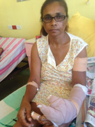 The wounded Savitree Sankumar in her hospital bed yesterday